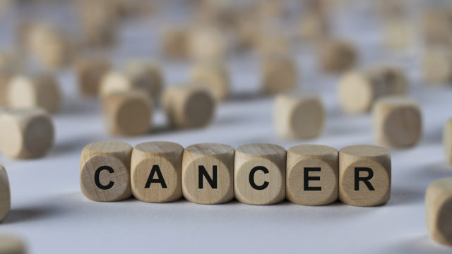cancer - cube with letters, sign with wooden cubes